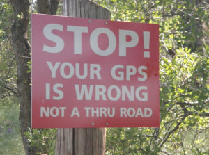 Road sign stating GPS is wrong